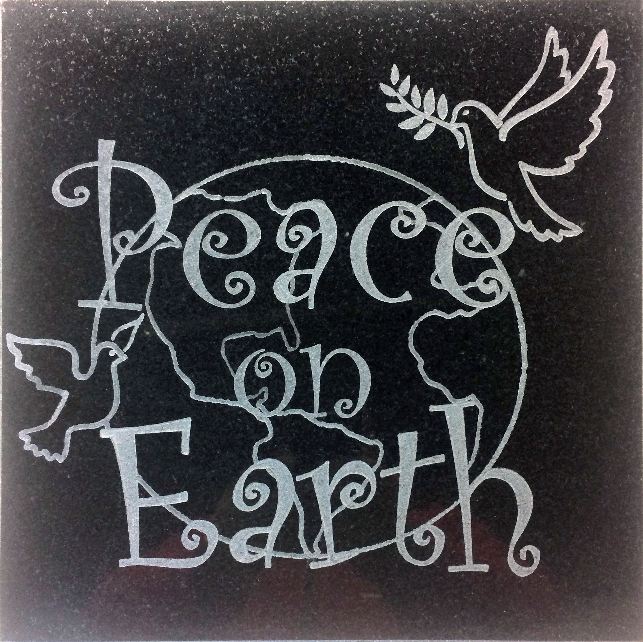 "Image logo for 12"" X 12"" Engraved Black Granite Tile - Peace on Earth"